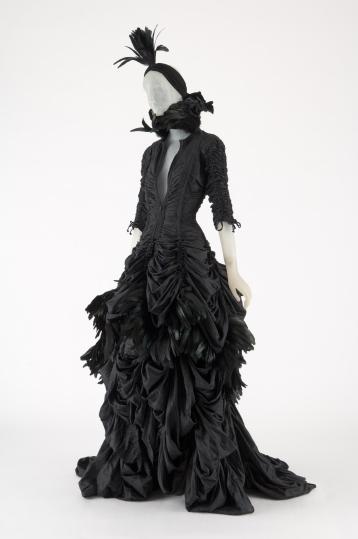 NORMA KAMALI, black parachute cloth and feather jacket, skirt, and turban, 2011, USA, Photograph MFIT / CFDA