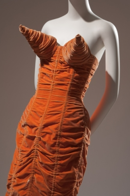 Jean Paul Gaultier, orange shirred-velvet dress with cone bust and back lacing, 1984, France